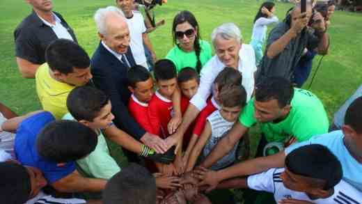 Former president Shimon Peres at the kick-off event of a Jewish-Arab coexistence soccer program at Kibbutz Dorot on September 1, 2014
