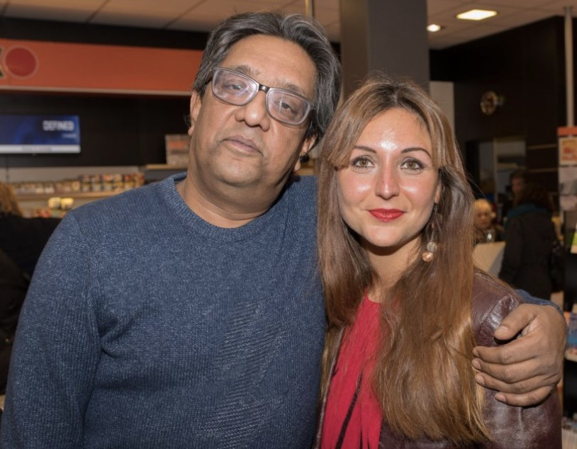 Prem Radhakishun op de foto met Dina-Perla de Winter.
